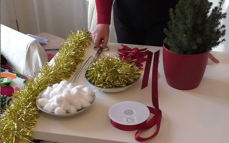 Decorating a Christmas tree for the table