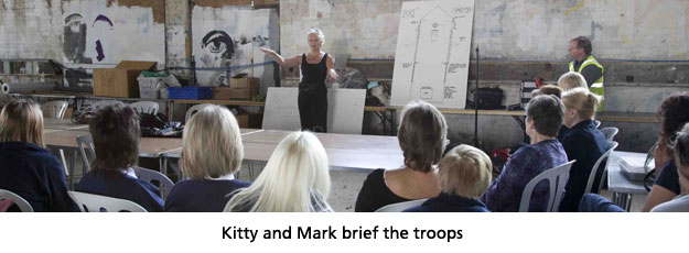 Kitty and Mark brief the troops