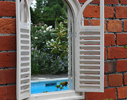 Garden wall mirror with shutters