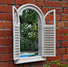 Wall mirror with shutters
