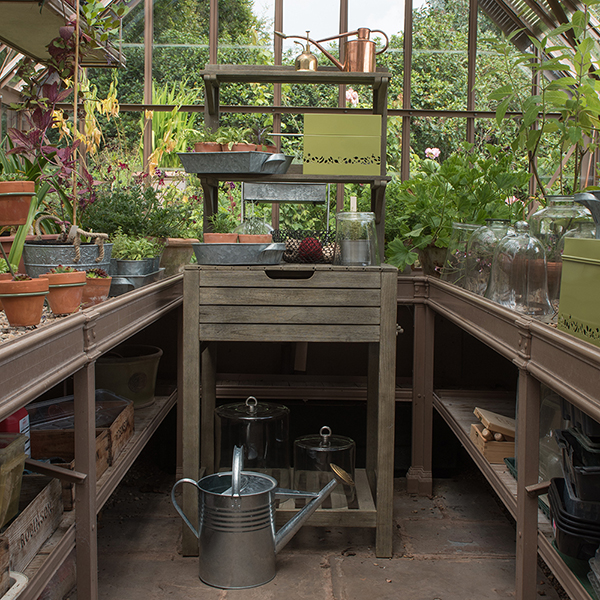 Space saving potting bench with storage