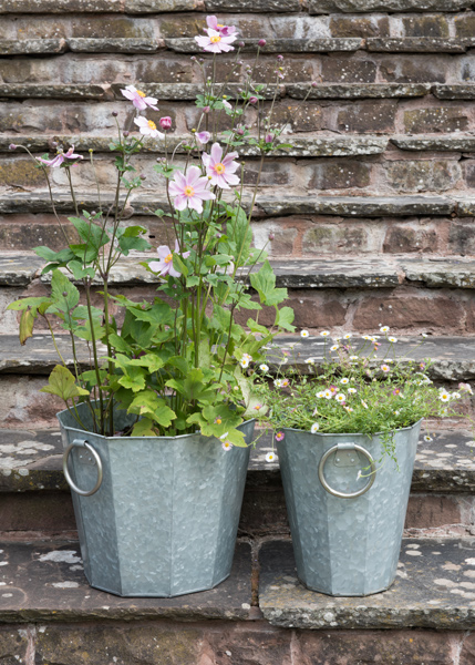 Faceted galvanised planter