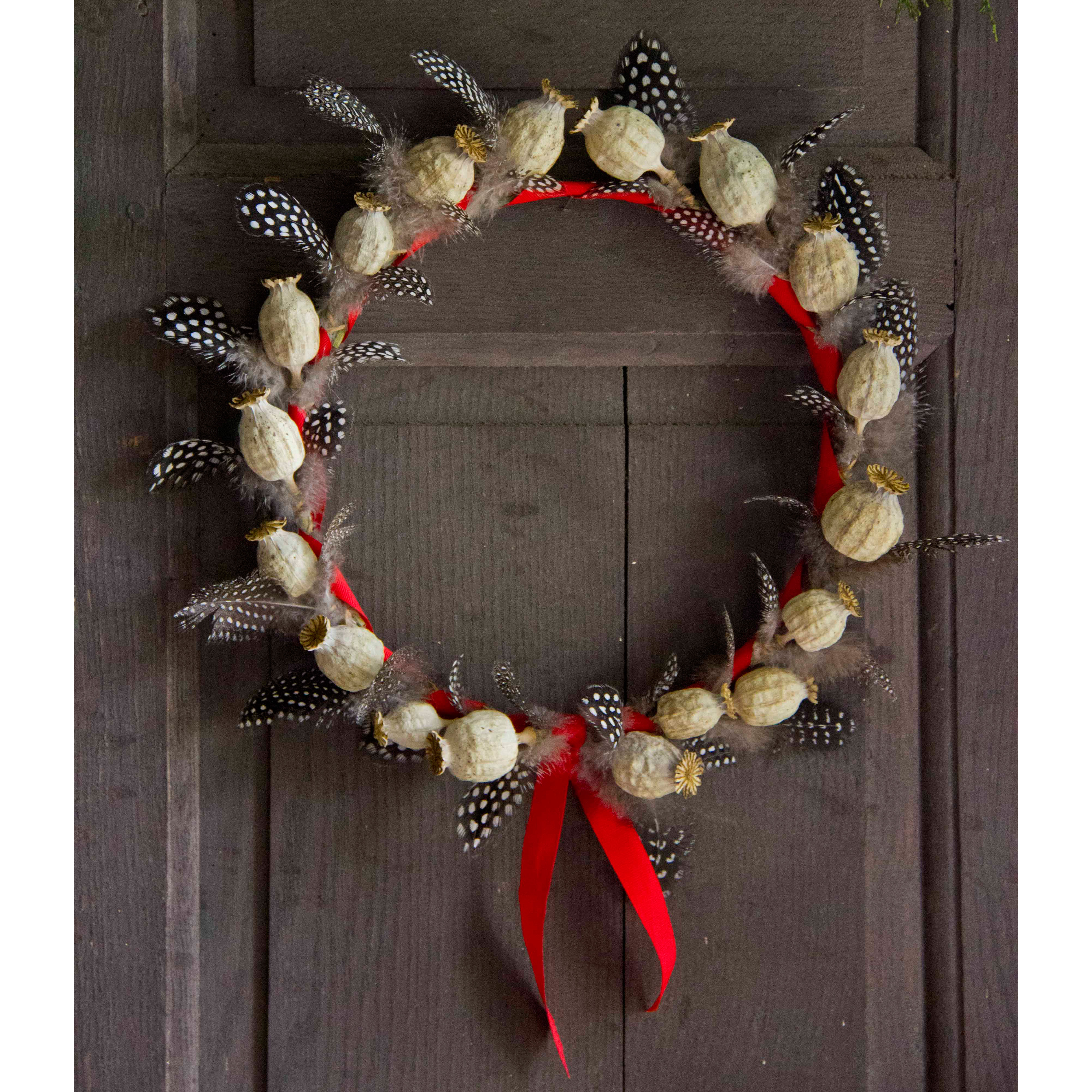 Click to view product details and reviews for Poppy Seed Head And Guinea Fowl Feather Wreath.