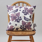 Blackbird and bramble cushion