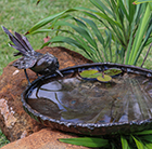 Metal wagtail bird bath